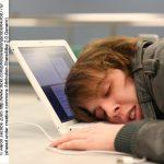 Boy asleep on laptop